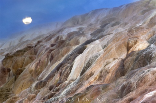 Moonrise over mineral terraces, Yellowstone National Park, Wyoming